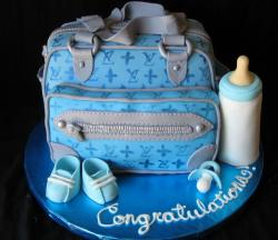 Designer handbag and baby shoes baby shower cake.JPG