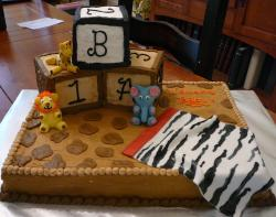 Chocolate baby shower cake with play blocks and jungle animals and zebra blanket.JPG