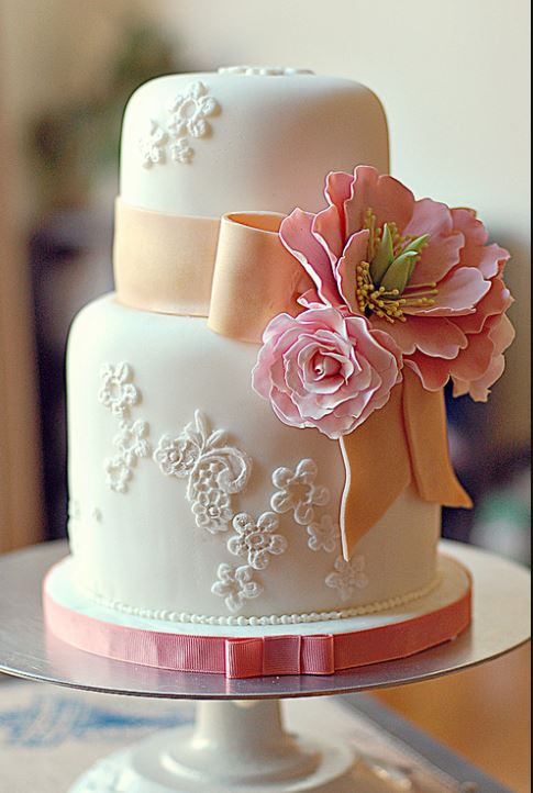 2 tier small mini wedding cake in white with pink ribbon and pink flower and orange bow.JPG