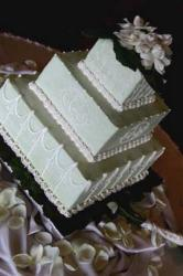 Square wedding cake with flowers on top