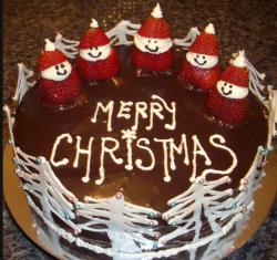 Merry Christmas chcolate round cake with figures made from fresh strawberries.JPG