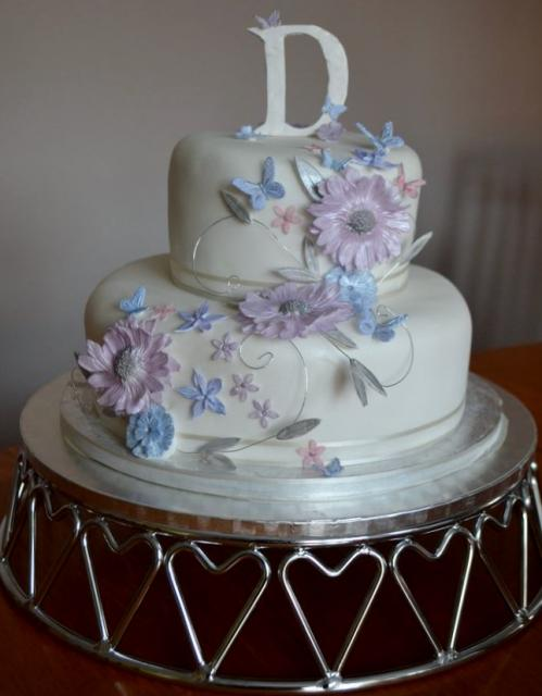 2 Tier White Round Birthday Cake With Flowers And Monogram