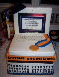 Very cool engineering graduation cakes shaped of a white laptop.PNG