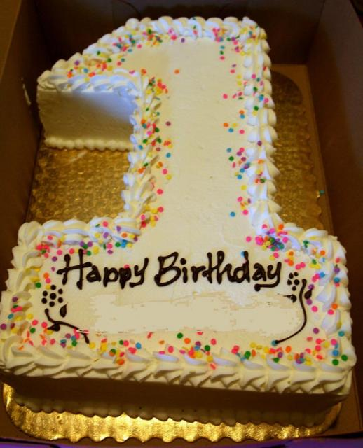 First birthday cake in the shape of the number one.JPG