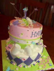 Cool two tier birthday cake with bowties and butterflies.JPG