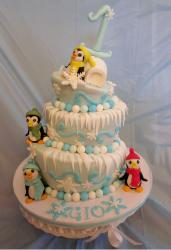 3 tier topsy turvy first birthday cake with penguins and igloo and the number 1 as toppers.JPG