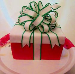 Red gift box cake with white bow and green trim.JPG