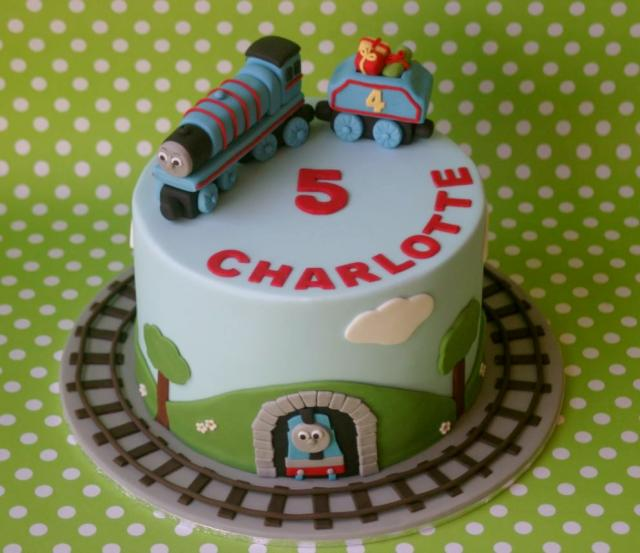 Thomas the Train cake with tracks surrounding for 5 year old.JPG
