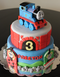 Professonal kids birthday cake with Thomas and friends cake theme with Thomas the train cake topper.PNG