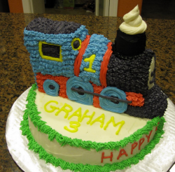 First birthday cake with Thomas the train engine cake shape.PNG