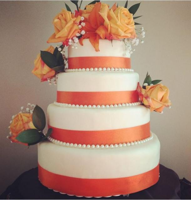 orange and white wedding cakes four tier white wedding cake with orange bands and 18042