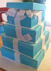 4 tier blue gift box cake with white pearls and ribbons.JPG