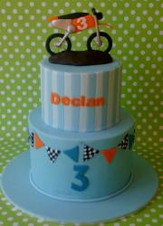 2 tier powder blue cake for 3-year-old with dirt bike on top.JPG