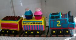 Thomas the Train cake for 2-year-old with 2 cars and 2 cupcakes.JPG