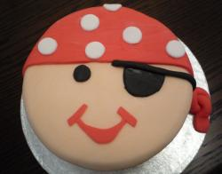 Round happy Pirate face birthday cake.JPG