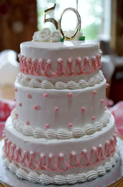 Three Tier 50th Birthday Cake For Woman With Pink Strings