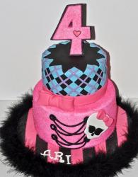 2 tier pink and blue 2 tier birthday cake for 4-year-old girl with number 4 on top.JPG