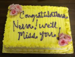 Bright yellow Retirement cake photos.jpg