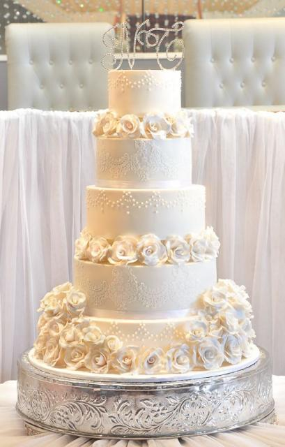 Five tier elegant ivory wedding cake with white roses and crystal monogram toppers.JPG