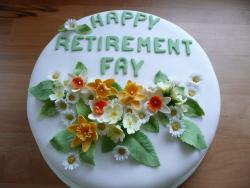 Green and floral retirement cake photos.jpg