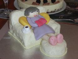 idea for mother retirement cake_cake of a woman sleeping on the chair with a book in her hands.jpg