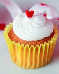 Valentine theme cupcake with white cream and red heart on top.JPG