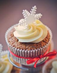 Winter theme chocolate cupcake with vanilla frosting and snowflake and red bow.JPG
