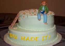 Modern pretty retirement cake with woman topper.jpg