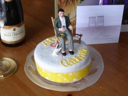 Retirement Cake with a man and a dog as topper.jpg