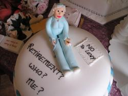 Retirement cake with grandmother as a topper.jpg