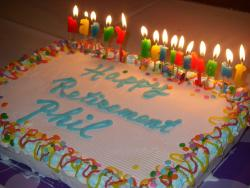 Retirement Cake with lots of candles in many colors.jpg