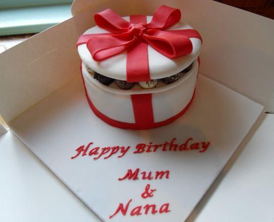 White Round Giftbox Cake With Red Ribbon Bow Jpg