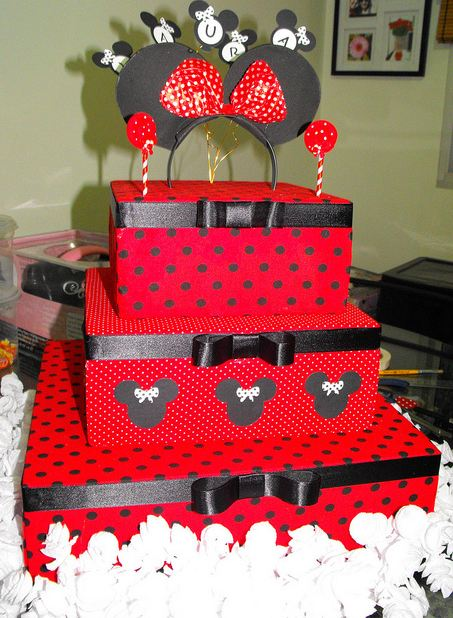 Three tier red birthday cake with black pokadots and ...