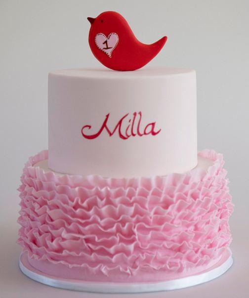 Two tier round elegant modern white first birthday cake with pink ...